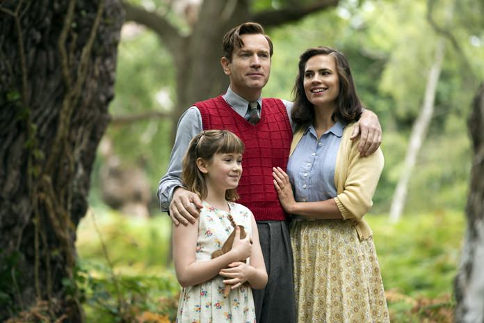 """This image shows (from left) Bronte Carmichael, Ewan McGregor and Hayley Atwell in a scene from """"Christopher Robin."""" (Laurie Sparham/Disney via AP)"""