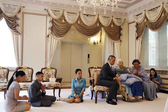 Her Majesty Queen Sirikit of the Ninth Reign is visited by her children His Majesty King Maha Vajiralongkorn Bodindradebayavarangkun and HRH Princess Maha Chakri Sirindhorn at the Chitralada Palace on HM the Queen's 86th birthday. Her grandchildren HRH Princess Sirivannavari Nariratana, (left), HRH Prince Dipangkorn Rasmijoti, (2nd left) and HRH Princess Bajrakitiyabha (center) were also present to pay their repects. Festivities were held throughout the Kingdom to celebrate our beloved Mother of the Thai Nation on Mother's Day. (The Royal Household Bureau via AP)