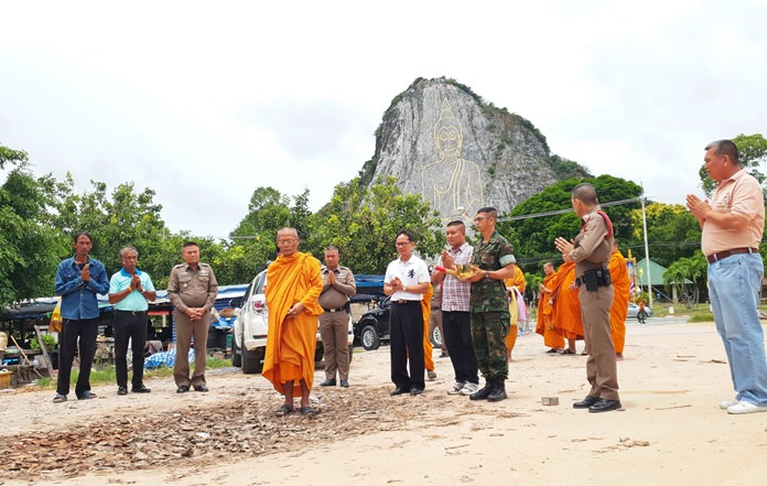 Sattahip residents pray for the spirits of a young couple gunned down at the foot of Buddha Mountain and for the capture of their alleged killer.