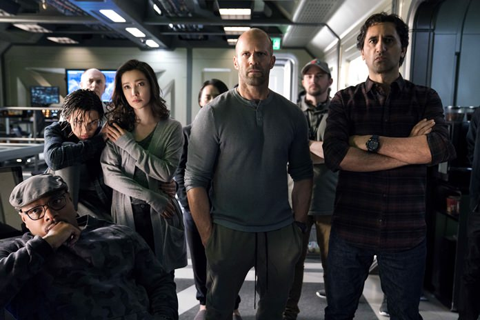 "This image shows (foreground from left) Page Kennedy, Ruby Rose, Li Bingbing, Jason Statham and Cliff Curtis in a scene from the film, ""The Meg."" (Warner Bros. Entertainment via AP)"