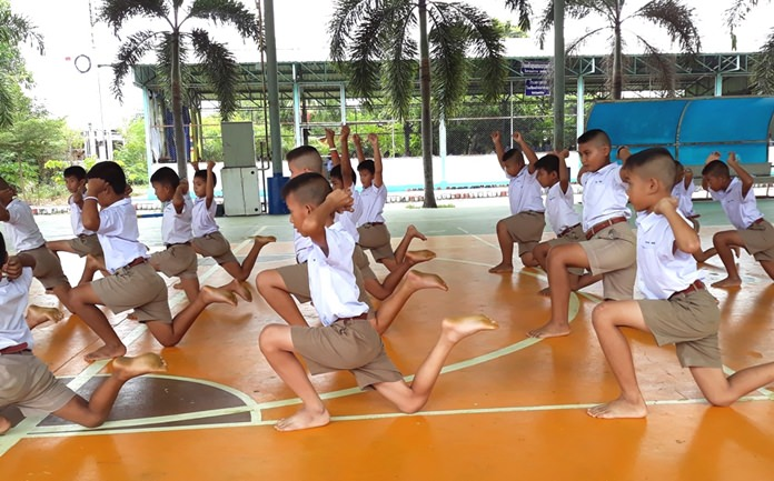 Children demonstrate their training exercises.