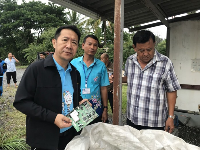 Banglamung District Chief Naris Niramaiwong looks suitably disgusted to find electronic waste in Takhiantia.