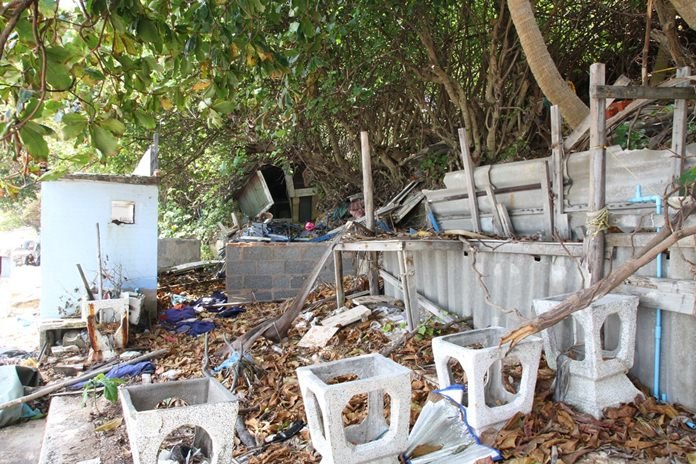 Unsightly debris sits on Yim Yom Beach after Pattaya officials and soldiers completed their demolition work.