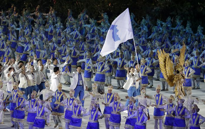 """The combined Koreas march into Gelora Bung Karno Stadium under the """"unification"""" flag during the opening ceremony for the 18th Asian Games in Jakarta, Indonesia, Saturday, Aug. 18. (AP Photo/Lee Jin-man)"""