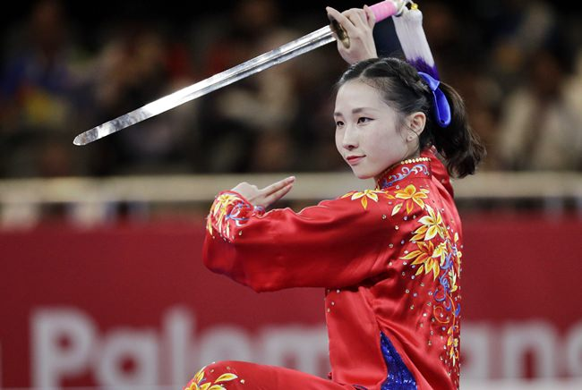 Hong Kong's Mok Uen Ying competes during the Women's Taijijian event at the 18th Asian Games in Jakarta, Monday, Aug. 20. (AP Photo/Aaron Favila)