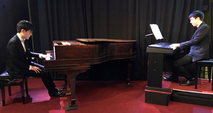 Gun (left) and Kant play the Ravel concerto at Ben's Theatre in Pattaya.