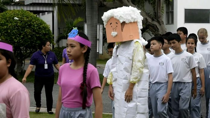 Students bring out a cardboard Albert Einstein during the opening parade.