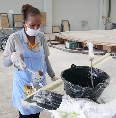 A skilled worker ensures the perfect mixture in producing fiberglass.