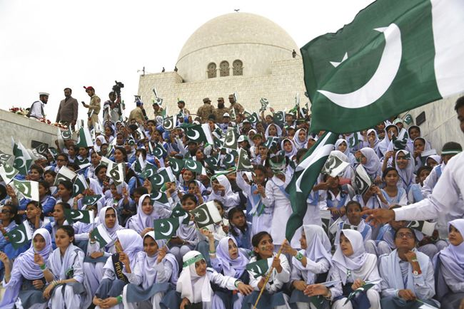 Students visit the mausoleum of Muhammad Ali Jinnah, founder of Pakistan, to celebrate the 71st Independence Day in Karachi, Pakistan, Tuesday, Aug. 14. (AP Photo/Shakil Adil)
