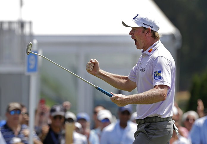 Brandt Snedeker reacts after making a birdie putt on the ninth hole during the first round of the Wyndham Championship golf tournament in Greensboro, N.C., Thursday, Aug. 16. Sneaker shot a 59 in the first round. (AP Photo/Chuck Burton)