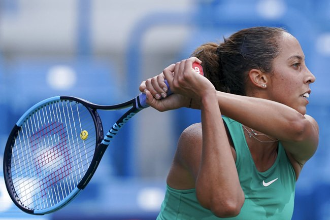 Madison Keys, of the United States, hits a return to Angelique Kerber, of Germany, at the Western & Southern Open tennis tournament Thursday, Aug. 16, in Mason, Ohio. (AP Photo/John Minchillo)