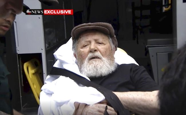 In this Monday, Aug. 20, 2018, frame from video, Jakiw Palij, a former Nazi concentration camp guard, is carried on a stretcher from his home in the Queens borough of New York. (ABC via AP)