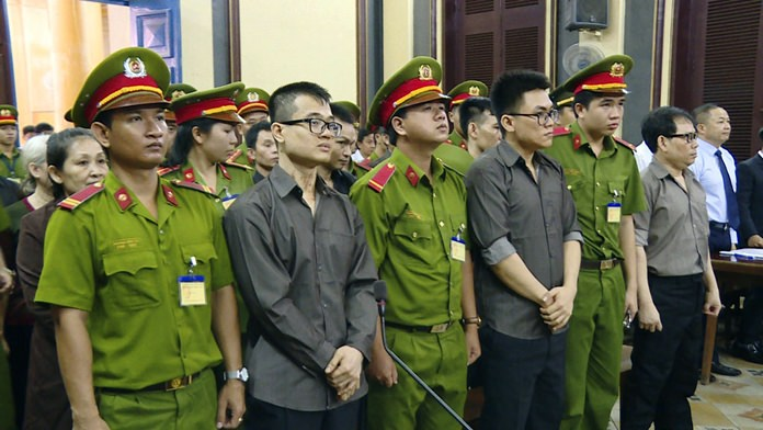 Members of the Provisional Central Government of Vietnam in exile in the United States stand trial in Ho Chi Minh City, Vietnam, Tuesday, Aug. 21. (Vietnam News Agency/Thanh Chung via AP)