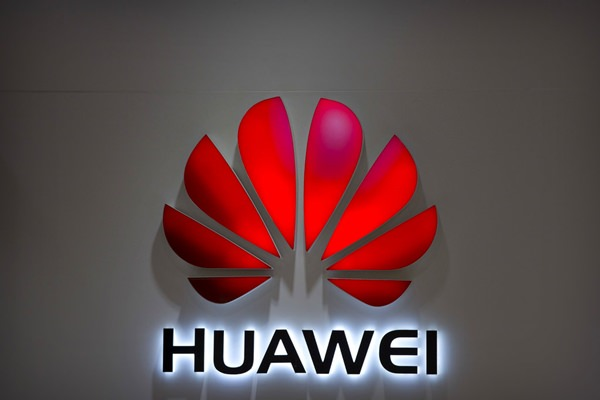 The Huawei logo is seen at a Huawei store at a shopping mall in Beijing, China. (AP Photo/Mark Schiefelbein)