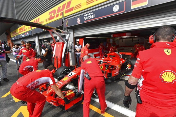 Ferrari driver Sebastian Vettel of Germany gets a pit service during the second practice session ahead of the Belgian Formula One Grand Prix in Spa-Francorchamps, Belgium, Friday, Aug. 24. (AP Photo/Geert Vanden Wijngaert)