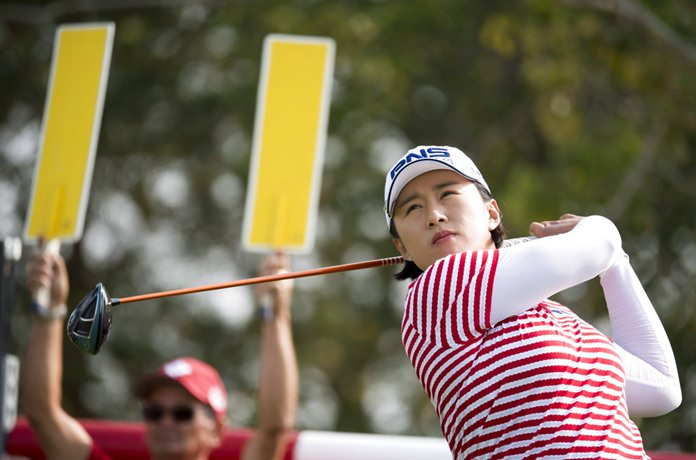 Amy Yang, of South Korea, tees off of the 18th hole during the women's Canadian Open golf tournament in Regina, Saskatchewan, Friday, Aug. 24. (Jonathan Hayward/The Canadian Press via AP)