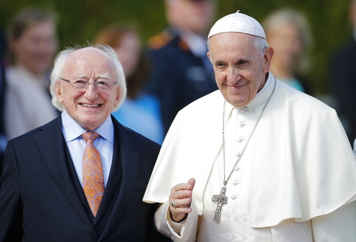 Pope Francis, right, is flanked by Irish President Michael D. Higgins, upon his arrival at the Presidential residence in Dublin, Ireland, Saturday, Aug. 25. Pope Francis is on a two-day visit to Ireland. (AP Photo/Peter Morrison)