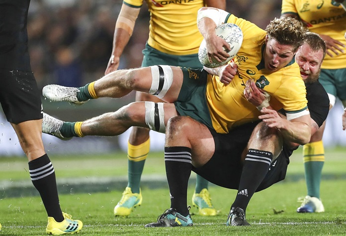 Australia's Michael Hooper is tackled by New Zealand's Joe Moody during the Bledisloe Cup rugby test match at Eden Park in Auckland, New Zealand, Saturday Aug. 25. (AP Photo/David Rowland)