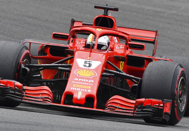 Ferrari driver Sebastian Vettel of Germany steers his car during the Belgian Formula One Grand Prix in Spa-Francorchamps, Belgium, Sunday, Aug. 26. (AP Photo/Geert Vanden Wijngaert)