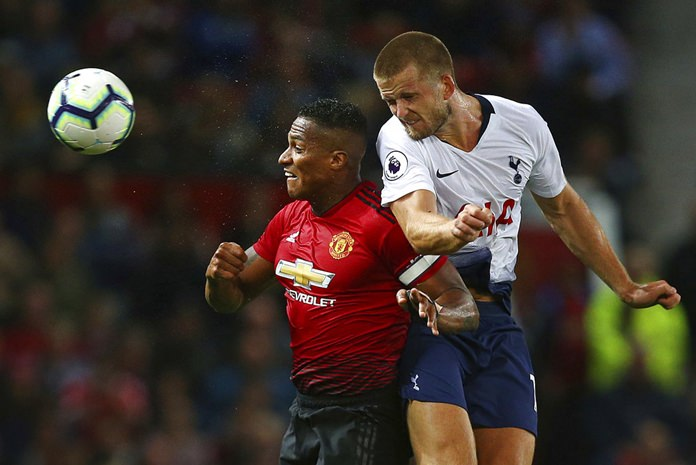 Manchester United's Antonio Valencia, left, and Tottenham Hotspur's Eric Dier battle for the ball during the English Premier League soccer match between Manchester United and Tottenham Hotspur at Old Trafford stadium in Manchester, Monday, Aug. 27. (AP Photo/Dave Thompson)