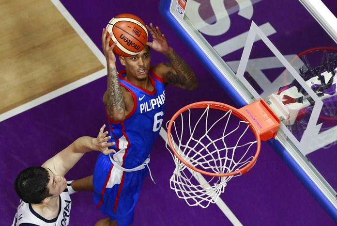 Philippines' Jordan Clarkson shoots as South Korea's Lee Seoung-hyun tries to block during the men's basketball competition at the 18th Asian Games in Jakarta, Indonesia, Monday, Aug. 27. (AP Photo/Dita Alangkara)
