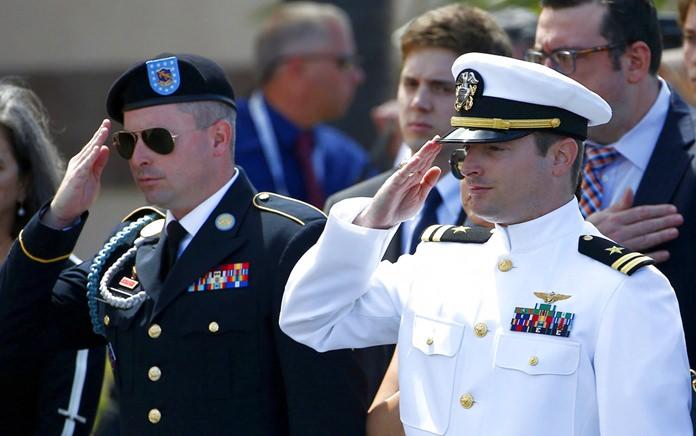 Jimmy McCain, left, and Jack McCain salute their father, Sen. John McCain, R-Ariz., after a memorial service at North Phoenix Baptist Church Thursday, Aug. 30, 2018, in Phoenix. (AP Photo/Ross D. Franklin)