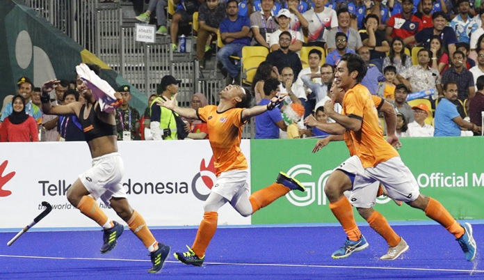 Malaysia's team jubilate after winning against India during their men's hockey semi-final match at the 18th Asian Games in Jakarta, Indonesia, Thursday, Aug. 30, 2018. (AP Photo/Aaron Favila)
