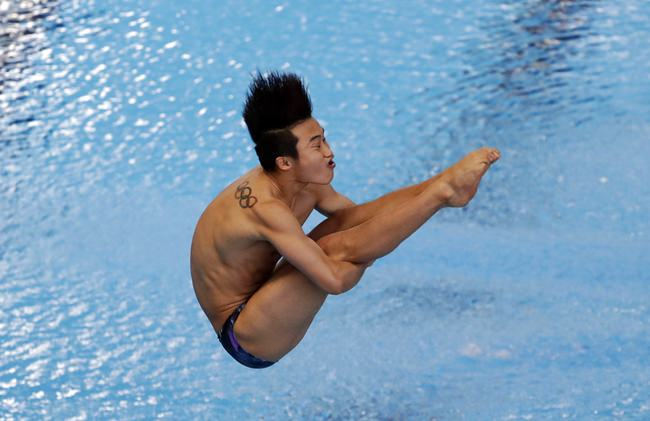 South Korea's Woo Ha-ram competes during the men's 1m springboard diving at the 18th Asian Games in Jakarta, Indonesia, Thursday, Aug. 30, 2018. (AP Photo/Lee Jin-man)
