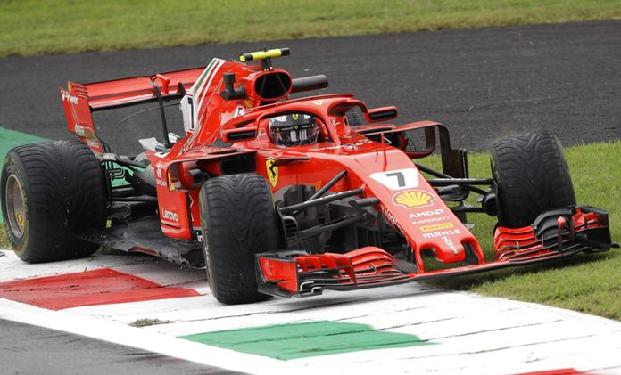 Ferrari driver Kimi Raikkonen of Finland takes a tour on the grass during practice at the Monza racetrack, in Monza, Italy , Friday, Aug. 31, 2018. The Formula one race will be held on Sunday. (AP Photo/Luca Bruno)