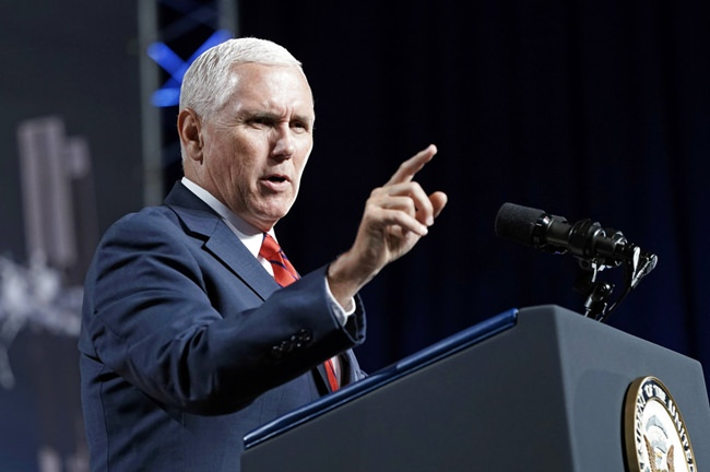 """FILE - In this Aug. 23, 2018, file photo, Vice President Mike Pence speaks during a visit to NASA's Johnson Space Center in Houston. Pence says he's """"100 percent confident"""" that no one on his staff was involved with the anonymous New York Times column criticizing President Donald Trump's leadership. (AP Photo/David J. Phillip, File)"""