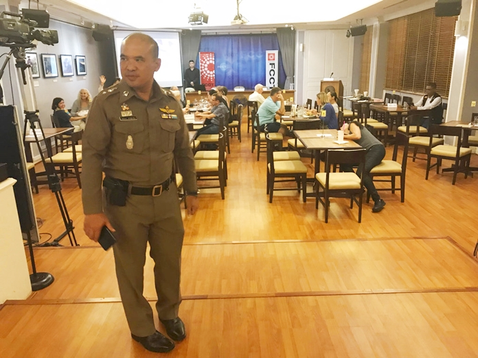 """In this Monday Sept. 10, 2018, photo, a Thai policeman stands inside Foreign Correspondents' Club of Thailand during an event titled: """"Will Myanmar's General Ever Face Justice for International Crimes"""" in Bangkok, Thailand. Police shut down a forum organized by foreign journalists to discuss whether senior military officers in Myanmar should face justice for alleged human rights abuses committed by their forces against Rohingya Muslims and other ethnic minorities. (AP Photo/Tassanee Vejpongsa)"""