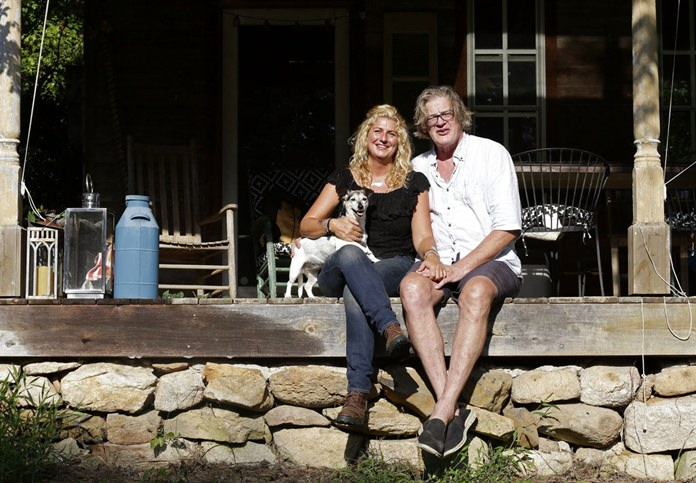 """Heather and Tom LaGarde are seen at their home near Saxapahaw, N.C., on Wednesday, Aug. 29, 2018. The LaGardes left New York following the events of 9/11. """"We try to echo some of what we loved"""" in New York, Heather says, """"but living in an easier, simpler, more natural place."""" (AP Photo/Gerry Broome)"""
