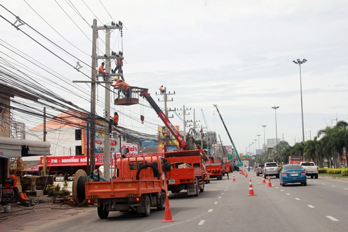 Workers from the Provincial Electricity Authority upgrade the power system on Sukhumvit Soi 54.