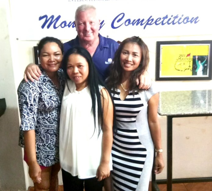 Brian Chapman (back) poses with the women winners on the day, Eng, Poopay, and Sasicha.