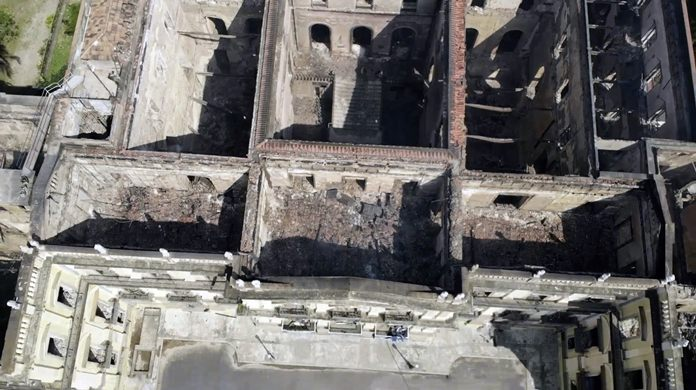 The National Museum, seen from above, stands gutted after an overnight fire in Rio de Janeiro, Brazil, Monday, Sept. 3, 2018. (AP Photo/Mario Lobao)