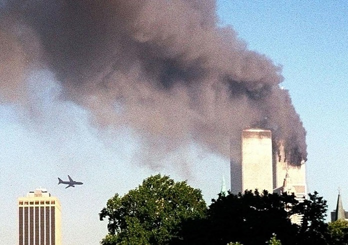 In this Tuesday, Sept. 11, 2001 file photo, United Airlines Flight 175 approaches the south tower of the World Trade Center in New York moments before collision, seen from the Brooklyn borough of New York. (AP Photo/ William Kratzke)
