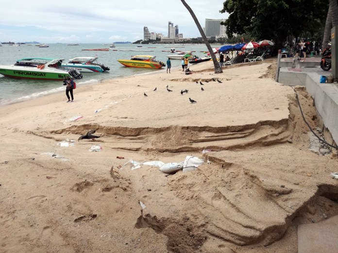 Heavy rain and flooding last week carved huge trenches out of the beach near the Pattaya Police Station. Pattaya officials said the sand-restoration project has only reached Soi 4, but when the work is finished at Soi 9 the area will be monitored to ensure that the new sand is not washed away.