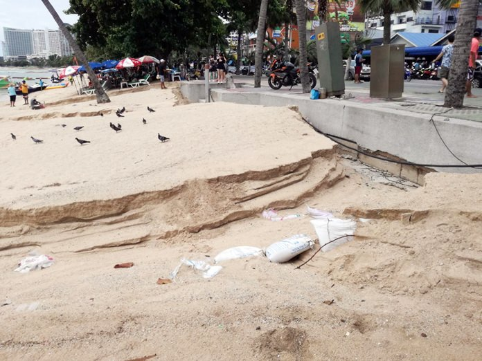 Heavy rain and flooding carved huge trenches out of the sand near the Pattaya Police Station.
