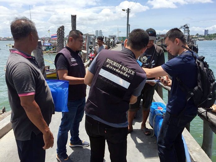 Pattaya tourist police hit the high seas to check fishing boats moored offshore, looking for criminals posing as fishermen and fugitives hiding out on boats.