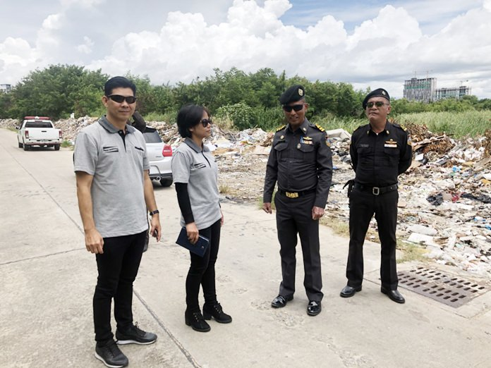 Pattaya regulatory officers and a group of internet garbage activists inspect a privately owned lot in Jomtien Beach repeatedly used as an illegal dump.