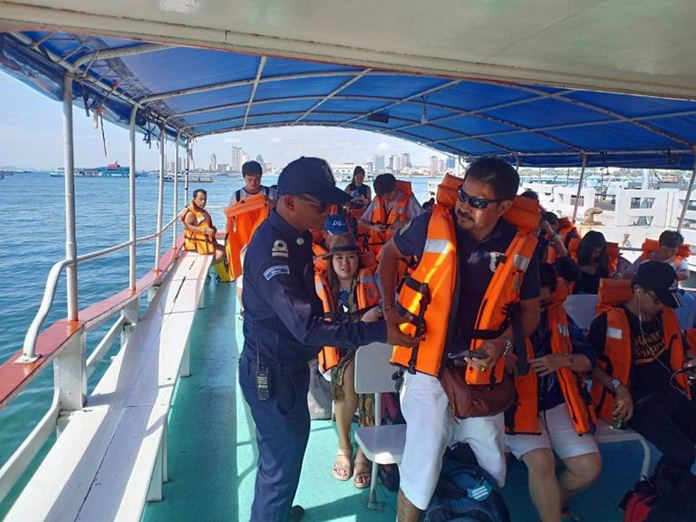 Sea Rescue Center officers remind tourists to always wear life jackets.