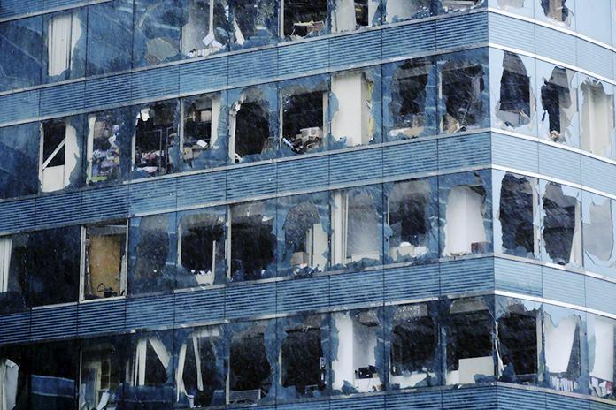 An office building's windows were damaged by Typhoon Mangkhut in Hong Kong Sunday, Sept. 16. (Wang Shen/Xinhua via AP)