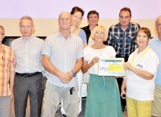 MC Judith Edmonds presents the PCEC's Certificate of Appreciation to Pattaya Players. From left to right - front row is Bob Smith, PCEC Board member and a Pattaya Player, Authur McNeil, Chris Harman, Wendy Khan, Judith Edmonds, and Doug Campbell – rear row is Mara Swankey, Pauline Elphick and Andrew Murphy.