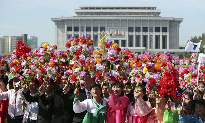 People fill the streets of Pyongyang to welcome South Korean President Moon Jae-in and the North Korean leader Kim Jong Un passing by during a car parade in North Korea. (Pyongyang Press Corps Pool via AP, File)