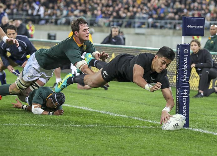 New Zealand's Rieko Ioane dives over to score a try during a rugby championship test match between South Africa and New Zealand in Wellington, New Zealand. (AP Photo/John Cowpland, File)