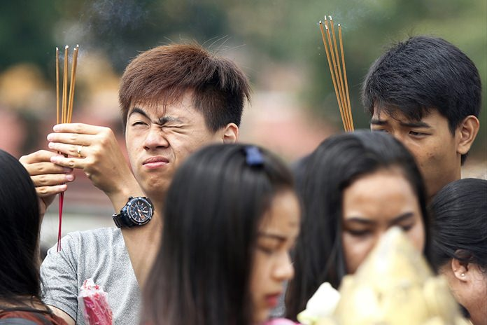 Buddhist followers offer prayer in front of the Royal Palace during Buddhist holidays in Phnom Penh, Cambodia. (AP Photo/Heng Sinith, File)