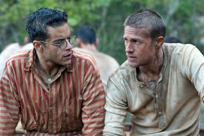 """This image shows Rami Malek (left) and Charlie Hunnam in a scene from """"Papillon."""" (Jose Haro/Bleecker Street via AP)"""