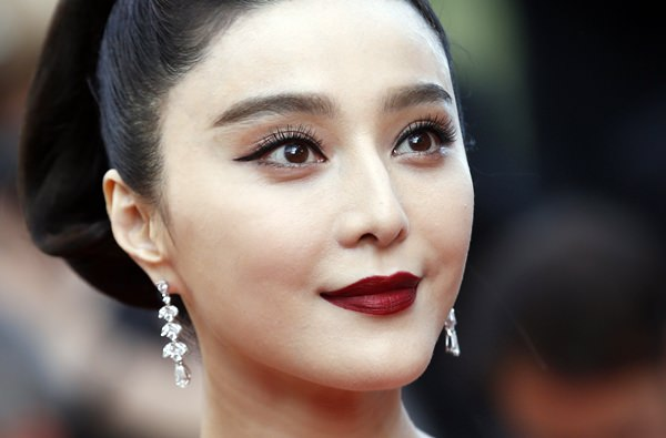 In this May 24, 2017, file photo, Fan Bingbing poses for photographers as she arrives for the screening of the film The Beguiled at the 70th international film festival, Cannes, southern France. (AP Photo/Alastair Grant)