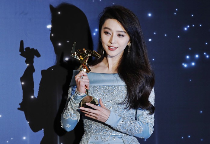 In this March 21, 2017, file photo, Chinese actress Fan Bingbing poses after winning the Best Actress Award of the Asian Film Awards in Hong Kong. (AP Photo/Kin Cheung, File)