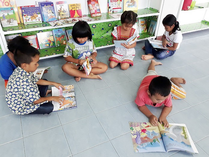 FOL children happily read their donated books.
